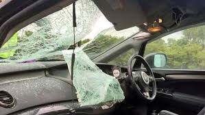 interior view of windshield after a ladder crashed through it